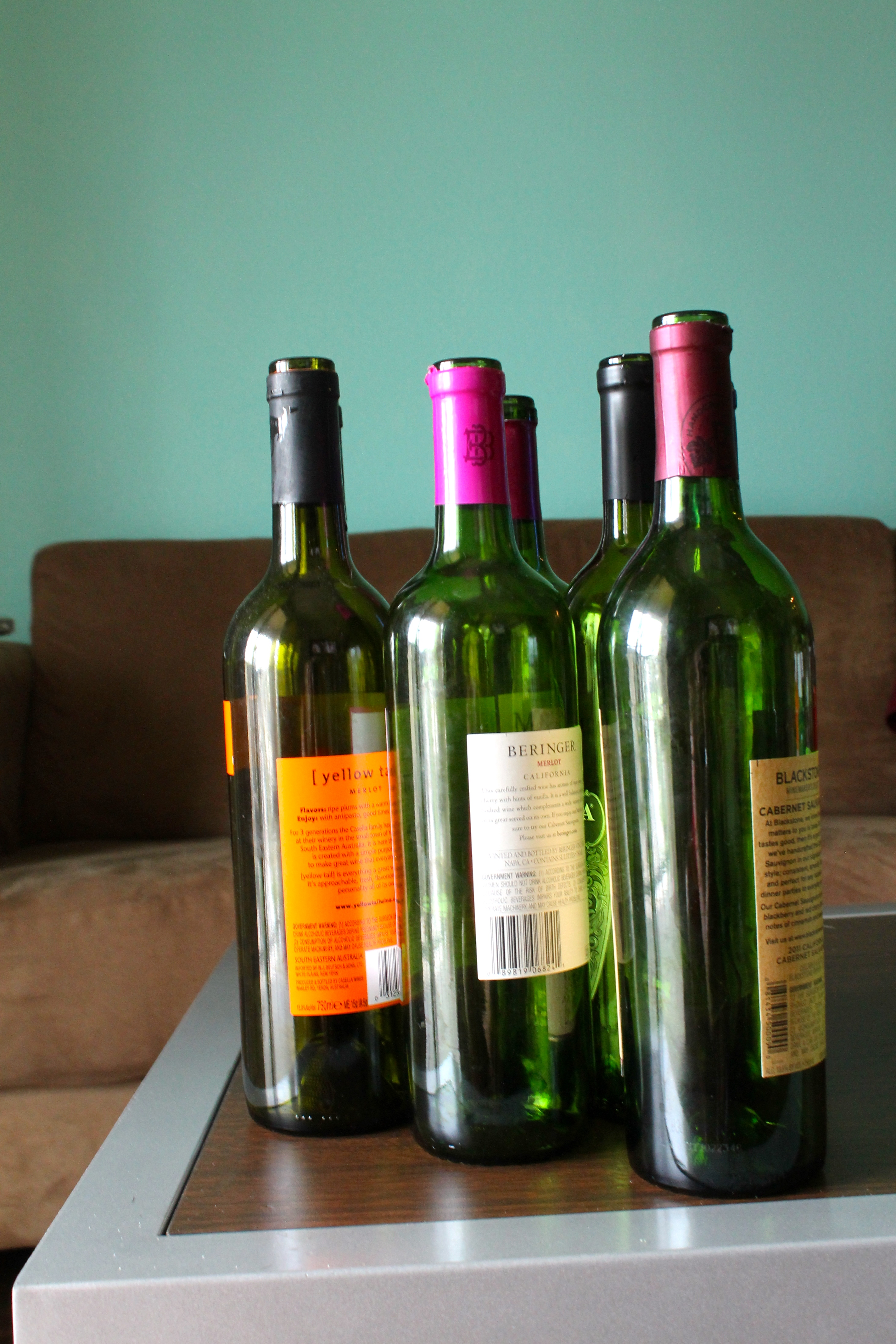 Diy halloween wine bottles decor a dash of sarah blog for What to make with empty wine bottles